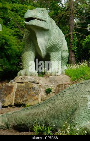An Iguanodon dinosaur statue in Crystal Palace Park. - Stock Photo