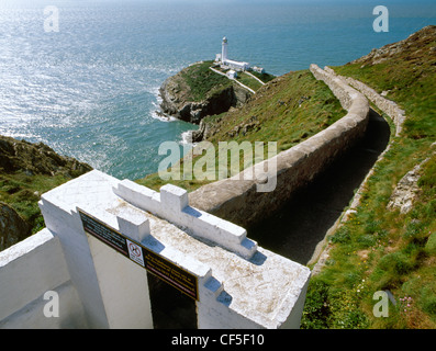 Gateway and access path leading to The South Stack lighthouse on a small, rocky island in the Irish Sea off the - Stock Photo