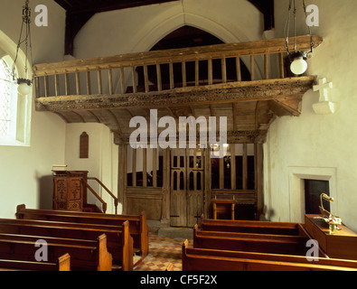 Late 15th century, carved and painted, wooden rood screen and loft inside St Eilian's church. - Stock Photo