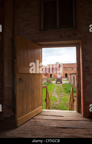 Open Barn Door view through a open barn door into the spring with trees and fresh