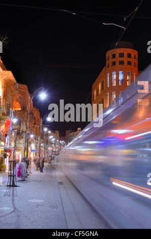 A light rail tram passes Jaffa Street in Jerusalem, Israel - Stock Photo