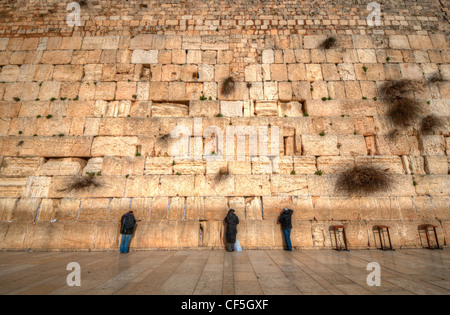 Worshipers at the Western Wall in the Old City of Jerusalem, Israel, the holiest site in Judaism. - Stock Photo