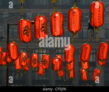 Colourful red lanterns hanging in Chinatown in London. - Stock Photo