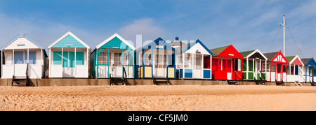 Colourful beach huts along the seafront in Southwold. - Stock Photo
