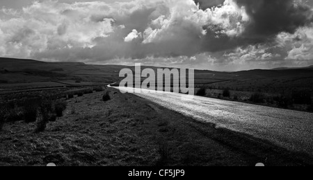 Black and white of the Durham Dales with single track road winding its way through Teesdale and Weardale - Stock Photo