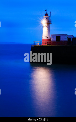The Lighthouse at the end of the Newlyn Pier at dawn. - Stock Photo
