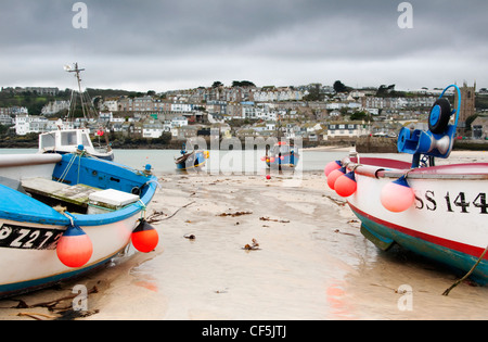 Fishing boats in St. Ives harbour. - Stock Photo