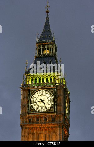Clock face of Big Ben, one of London's most iconic landmarks, at dusk. - Stock Photo