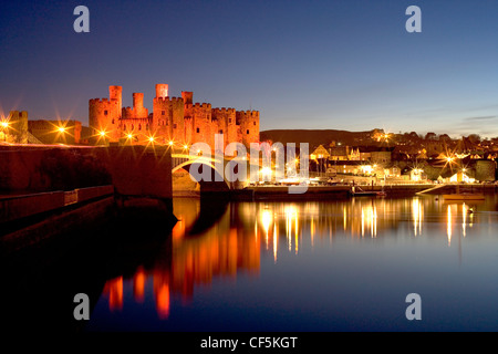 A view of Conwy Castle at dusk from over the river. The castle was an important part of King Edward I's plan of surrounding Wale