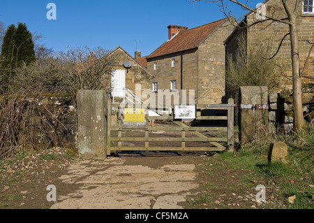 Farm gate and entrance to Daffy cafe near High Mill. - Stock Photo