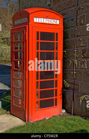 A traditional red telephone box. - Stock Photo