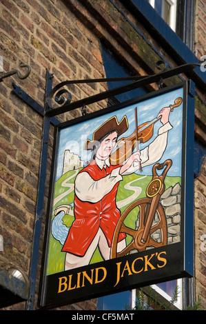 Blind Jacks pub sign hanging outside the pub in Market Square, Knaresborough. - Stock Photo