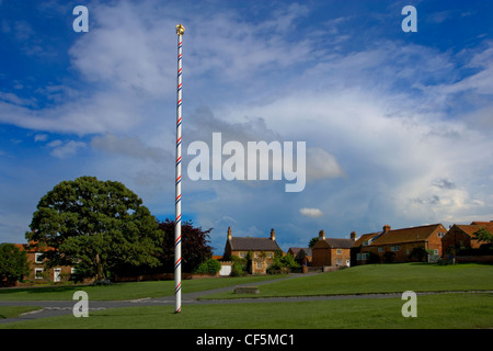 Traditional maypole on the village green. Aldborough is built on the foundations of a major Roman city. - Stock Photo