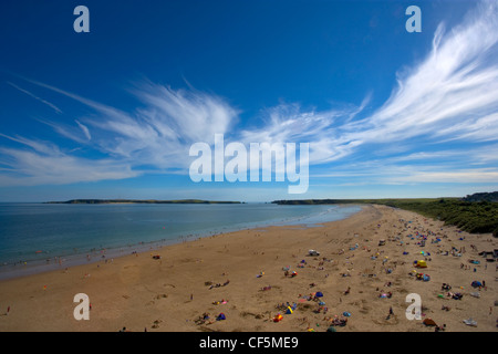 A view across South Beach and the Burrows toward Caldey Island. - Stock Photo