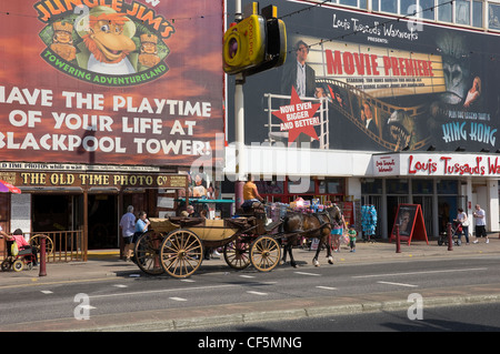 Horse and carriage outside Louis Tussaud's Waxworks on the Golden Mile in Blackpool. - Stock Photo