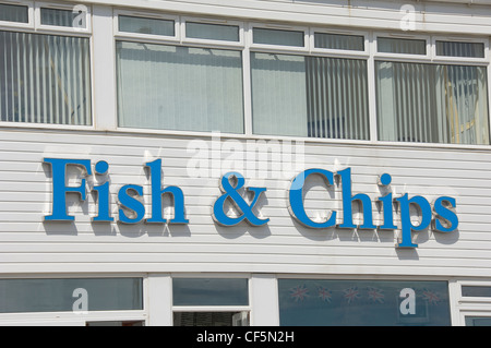 Sign above a fish and chip shop on the seafront in Bridlington. - Stock Photo