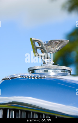 An iconic winged Bentley B car mascot. - Stock Photo