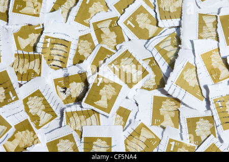 Used first class British stamps. - Stock Photo