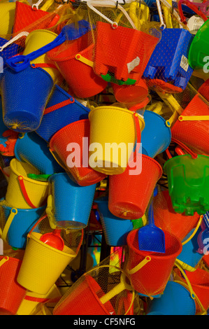 Childrens colourful plastic buckets and spades for sale on the seafront. - Stock Photo