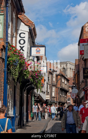 People shopping in the Shambles, thought by many to be Europe's best preserved medieval street. - Stock Photo