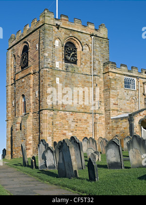St Mary's Church and graveyard on East Cliff above the old port of Whitby. - Stock Photo