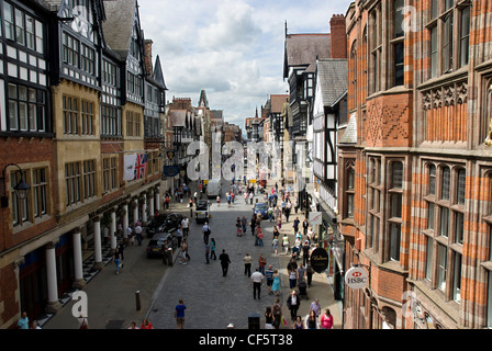 A view along Eastgate Street in Chester bustling with shoppers. - Stock Photo