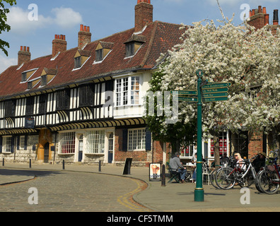 Cafe and tourist information sign outside St. William's College, founded in 1461 as a home for the Chantry Priests, - Stock Photo