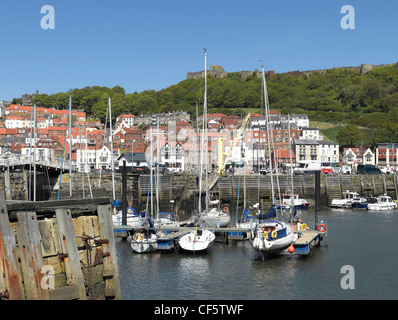 Small boats moored in Scarborough's Inner Harbour at low tide. - Stock Photo
