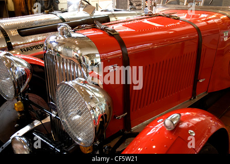 Close up of a Lagonda M45 Le Mans Replica with Napier-Railton 24 litre behind in the ERA shed at the Brooklands - Stock Photo