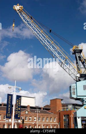 Old dock yard crane. The crane has been preserved as a feature of Gunwharf Quays at Portsmouth. - Stock Photo