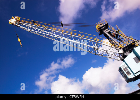 Looking up at an old dock yard crane. The crane has been preserved as a feature of Gunwharf Quays at Portsmouth. - Stock Photo