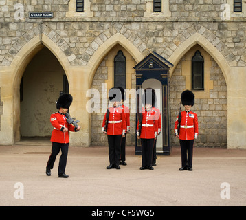 Changing the guard at Windsor Castle during the Garter Day Ceremony. - Stock Photo