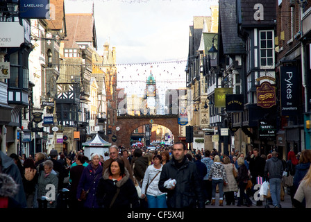 View along Eastgate Street packed with shoppers, towards the Eastgate Clock. - Stock Photo