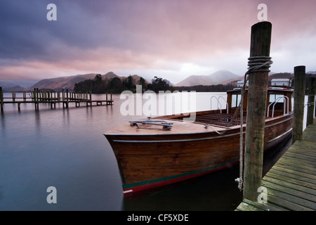 Boats tied up on the landing stage at Derwent Water. Watched over by the fells of Derwent, and Castlerigg, the lake - Stock Photo