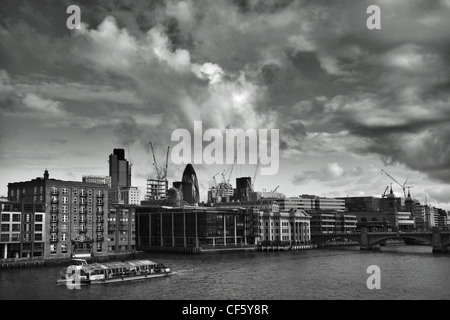 View across the River Thames towards iconic London landmarks, 'the Gherkin and Tower 42, (formerly known as the - Stock Photo