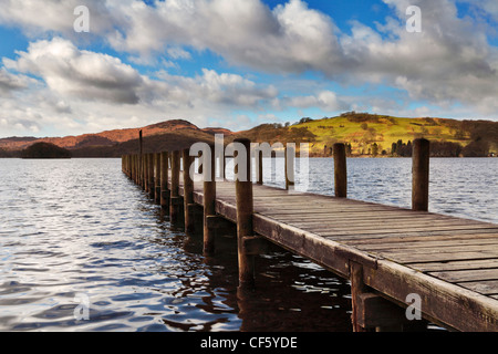 Jetty jutting out into Coniston Lake on a fine spring morning in the Lake District. - Stock Photo