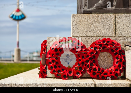 Poppy wreaths laid in remembrance at the foot of the war memorial on the seafront at Blackpool. - Stock Photo