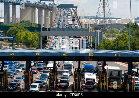 Traffic queueing at the toll booths at the end of the QE2 Bridge (Dartford River Crossing) as it moves into Kent - Stock Photo
