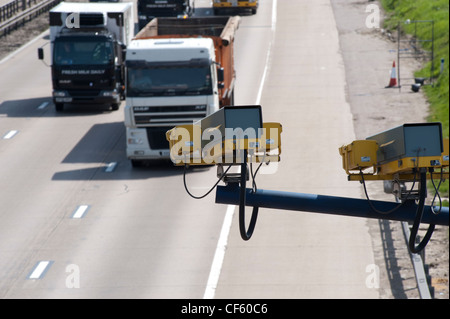CCTV (closed circuit television) monitoring traffic on the M25 in Essex. The UK has the highest amount of CCTV surveillance - Stock Photo