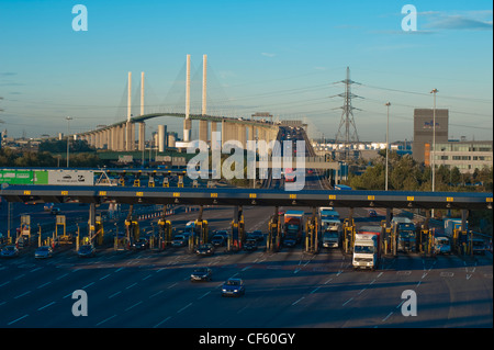 Traffic pulling away from the toll booths of the Dartford River crossing to enter Kent. - Stock Photo