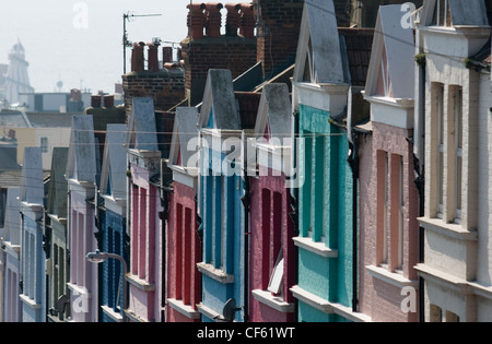 A row of brightly painted terrace houses in Brighton. - Stock Photo