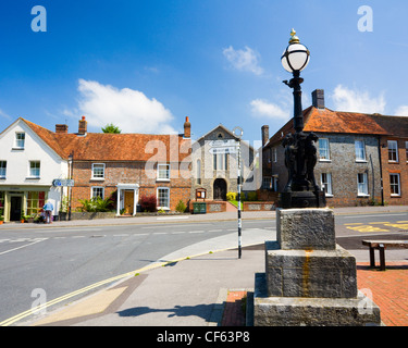 Lamp commemorating Queen Victoria's Diamond Jubilee in 1897 and signpost in the town centre. - Stock Photo