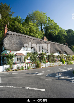A row of picturesque thatched cottages. - Stock Photo