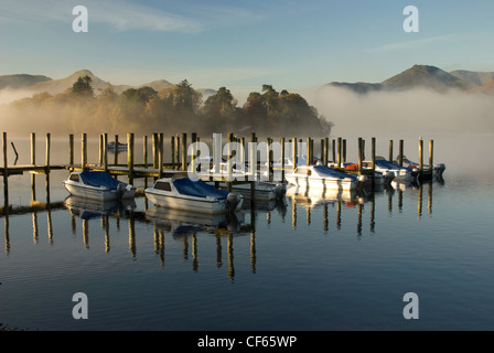 Early morning reflections on Derwentwater in Cumbria. - Stock Photo