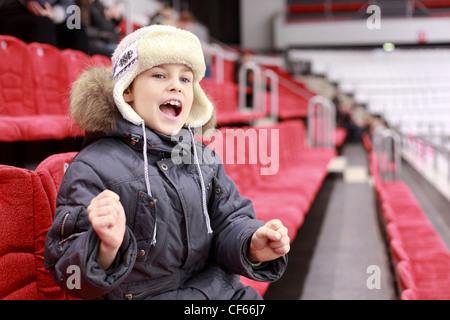 Boy loudly shouts on  hockey match - Stock Photo