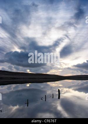 Sunrise over Girlsta Loch on Shetland. - Stock Photo