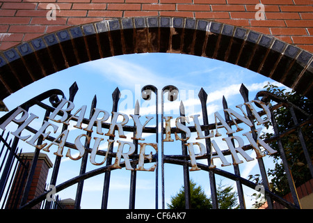 The metal gates to the entrance of the Barry Island Pleasure Beach in Glamorgan. - Stock Photo