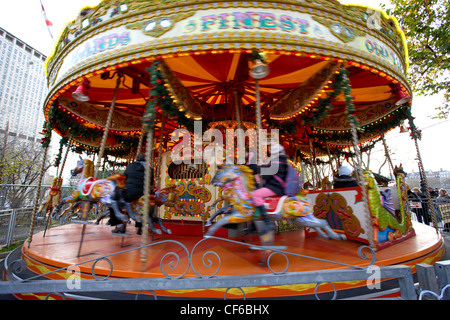 A carousel at the christmas market near to The Royal Festival Hall. - Stock Photo
