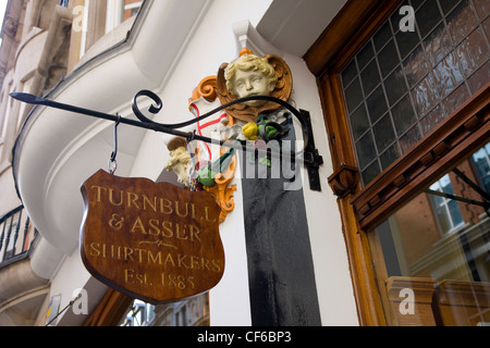 Looking up to the Turnbull and Asser shirtmakers shop sign in the City of Westminster. - Stock Photo