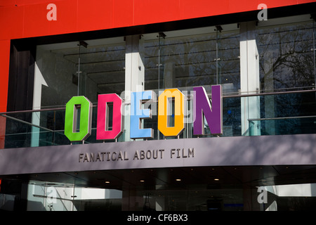 The colourful sign for the Odeon cinema in Leicester Square. - Stock Photo